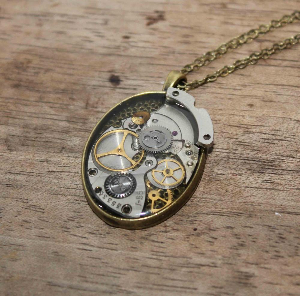 Pretty steampunk style pendant from vintage watch parts